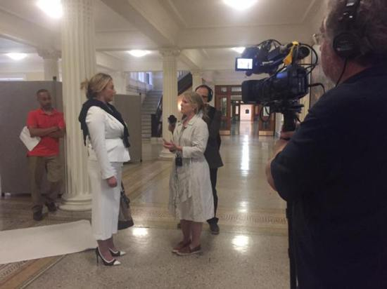 Interviews and documentary footage in the State House
